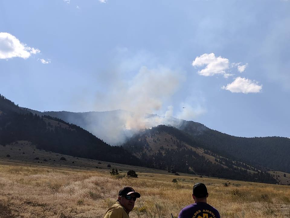 A wildfire burning west of Montana Highway 69 south of Boulder
